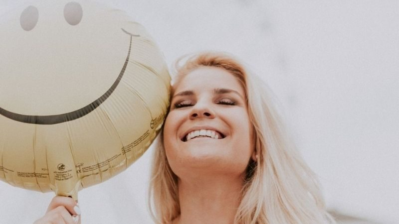 smiling women with balloon